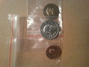 Image is 3 replica Roman coins individually packaged in small ziplock bags.