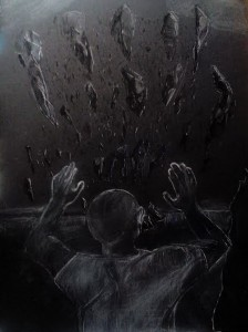 Image is a dark image of the back of a male with black shards of glass surrounding him. He appears racked in fear.